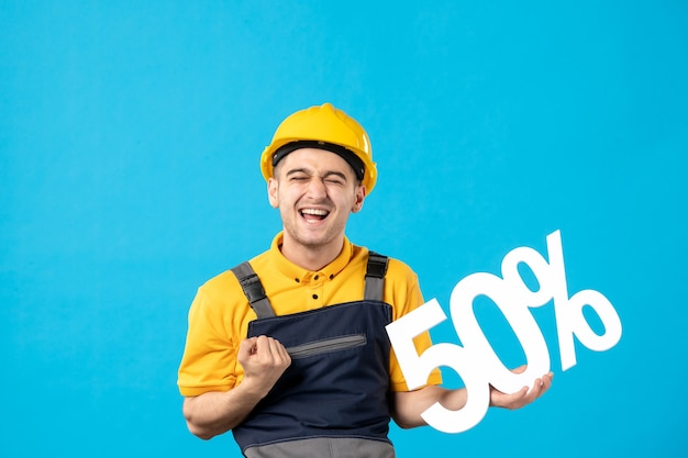 Front view happy male worker in uniform with writing on blue