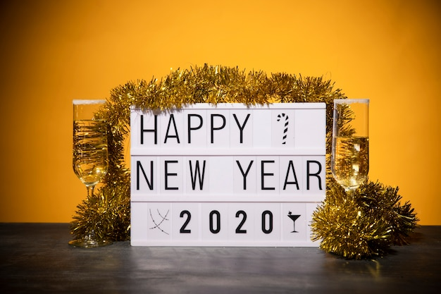 Front view happy new year sign on table