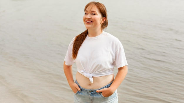 Front view of happy woman at the beach