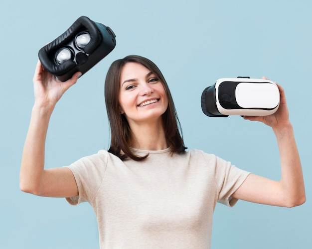 Front view of happy woman holding virtual reality headset