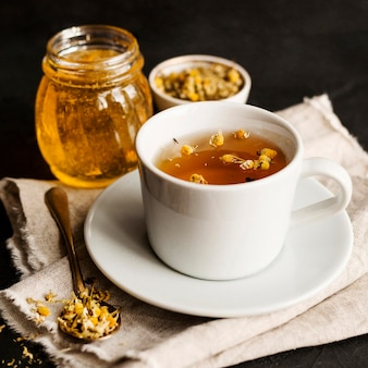Front view of herbal tea concept with honey