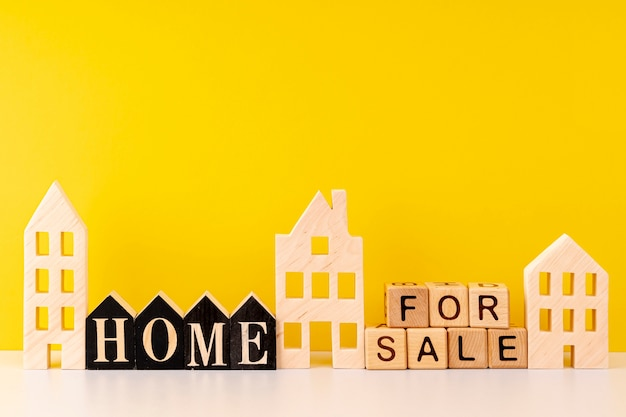 Front view home for sale lettering on yellow background