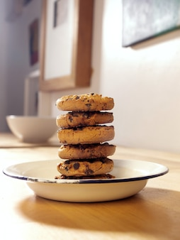 Front view of homemade cookie tower on a white pewter plate on a table in the house