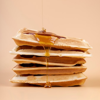 Front view of honey dripping on waffles