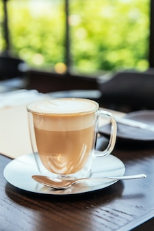 Front view of hot cappucino with blur green background