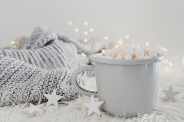 Front view hot chocolate with marshmallows and pullover
