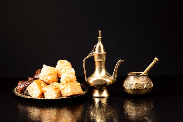 Front view islamic pastries with black background