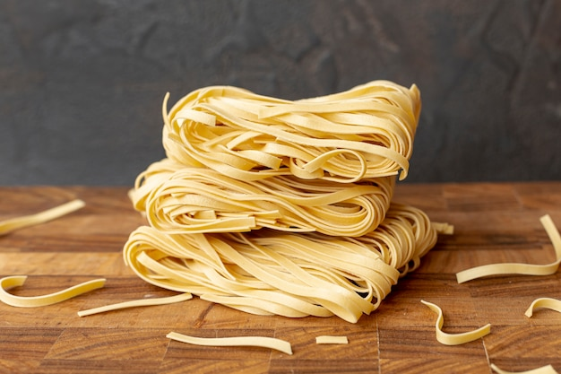 Front view of italian pasta on wooden table