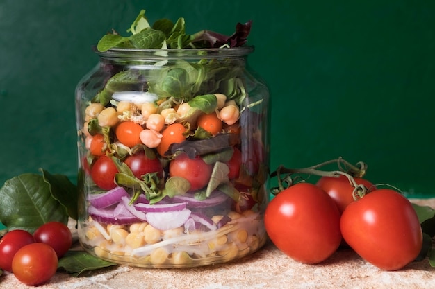 Front view jar filled with various fruit and veggies