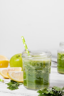 Front view of jar of healthy smoothie with apple
