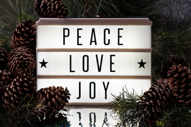 Front view joy love peace christmas lettering