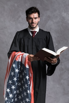 Front view judge with flag and opened book