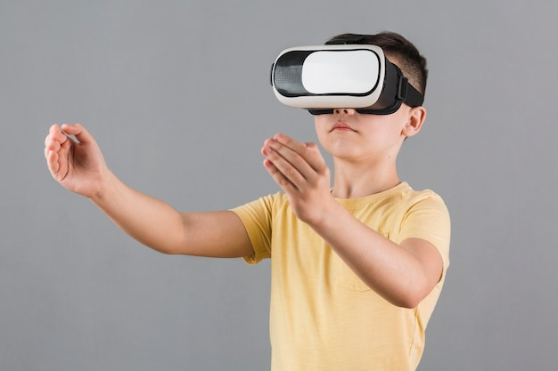 Front view of kid using virtual reality headset