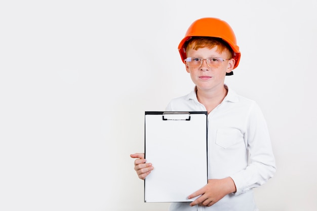 Front view kid with helmet and clipboard