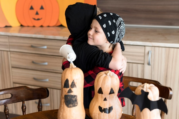 Front view of kids with halloween concept arrangements
