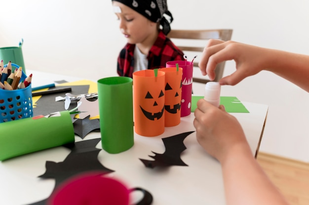 Front view of kids with halloween conceptt Free Photo