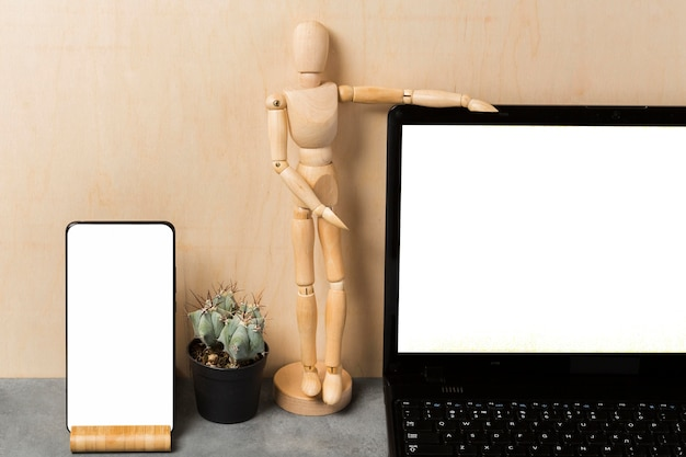 Front view of laptop and puppet with copy space