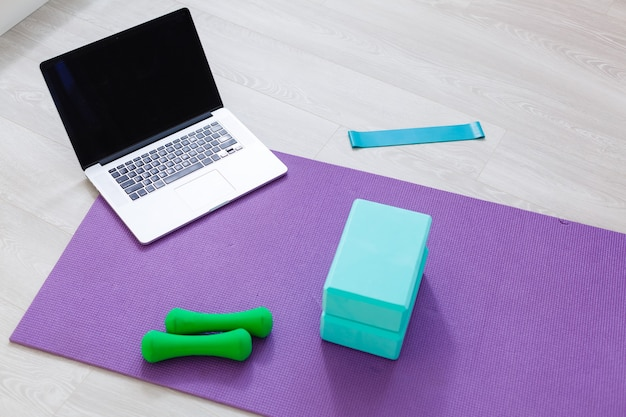 Front view of a laptop with blank copy space screen, yoga at home