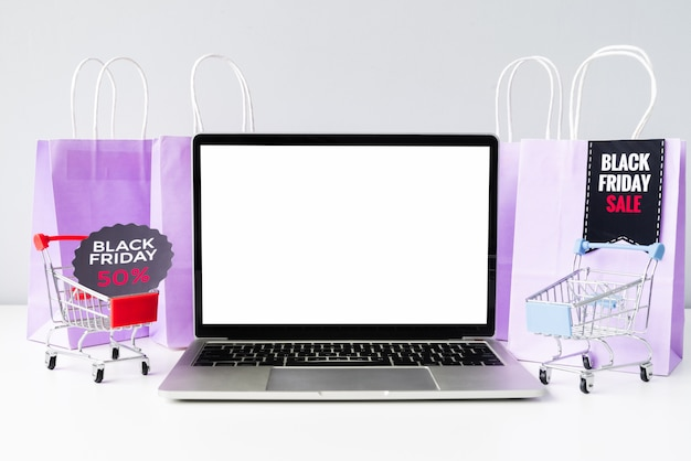 Front view laptop with shopping carts mock-up