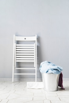 Front view laundry basket with white chair