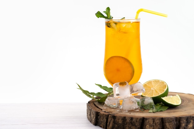 A front view lemon cocktail with ice cubes and lemon ono the white, drink juice fruit