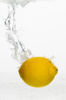 Front view of lemon in water with copy space