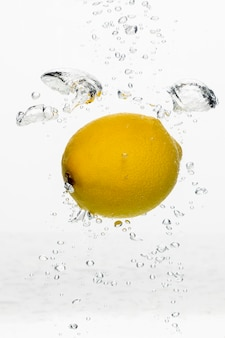 Front view of lemon in water