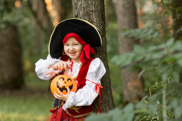 Front view of litte pirate girl concept Free Photo
