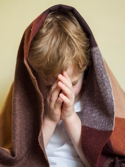 Front view of little boy praying