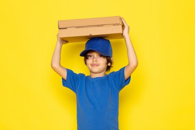 A front view little cute courier in blue t-shirt blue cap grey jeans