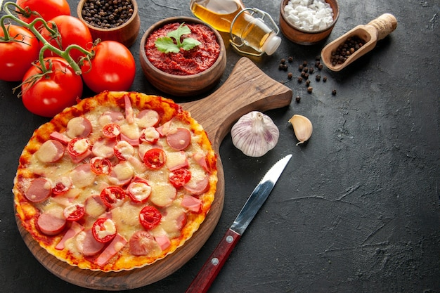 Front view little delicious pizza with fresh red tomatoes on dark salad food dough cake color photo fast-food delivery