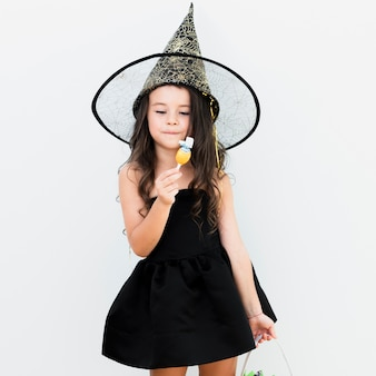 Front view little girl in witch costume for halloween