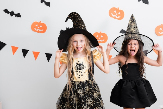 Front view little girls in witch costume for halloween