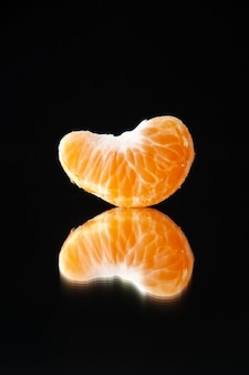 Front view little tangerine slice on a black wall drink tree citrus fruit juice darkness orange grapefruit