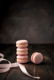 Front view of macarons with ribbon and copy space