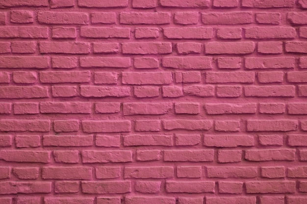 Front view of magenta colored old brick wall for background