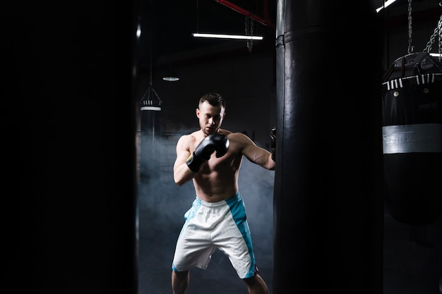 Front view male boxer training for a competition