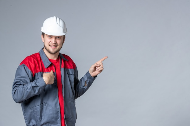 Front view male builder in uniform on light background