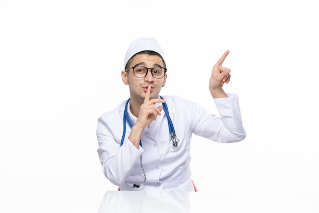 Front view male doctor in medical suit