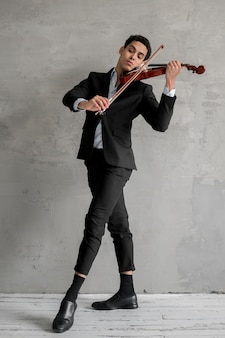 Front view of male musician playing violin