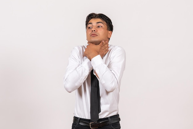 Front view male office worker chocking himself on white wall work male job business