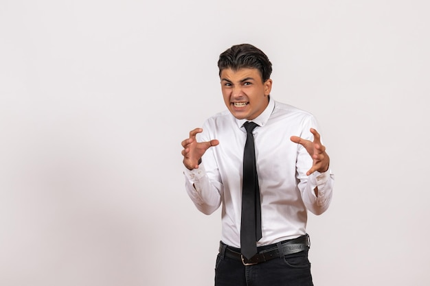 Front view male office worker emotionally posing on white wall work male job business