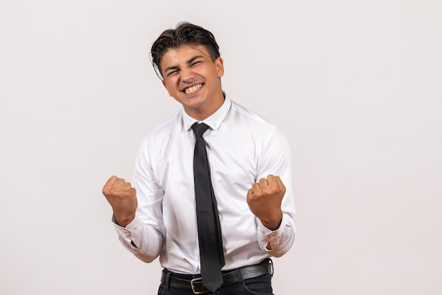 Front view male office worker feeling emotional on white wall work male job business