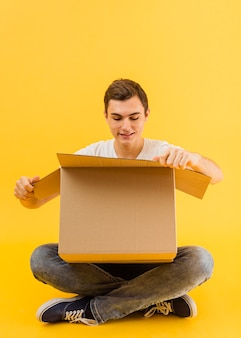 Front view male opening delivery package