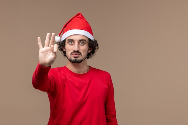 Front view male in red showing number on brown background holiday emotion christmas
