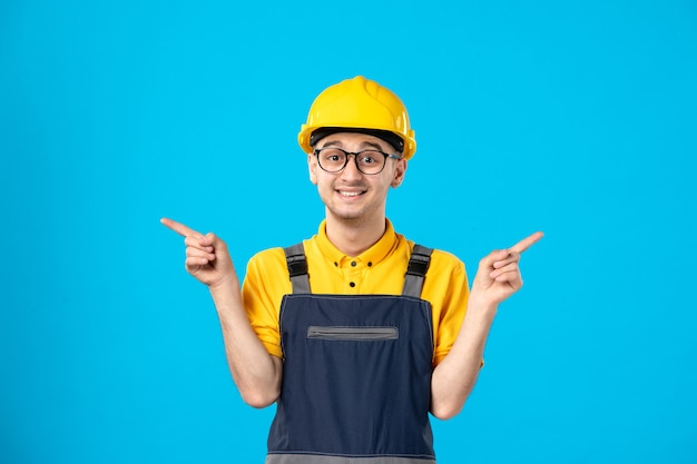 Front view male worker in uniform on blue