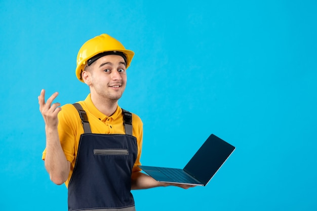 Front view male worker in uniform with laptop blue