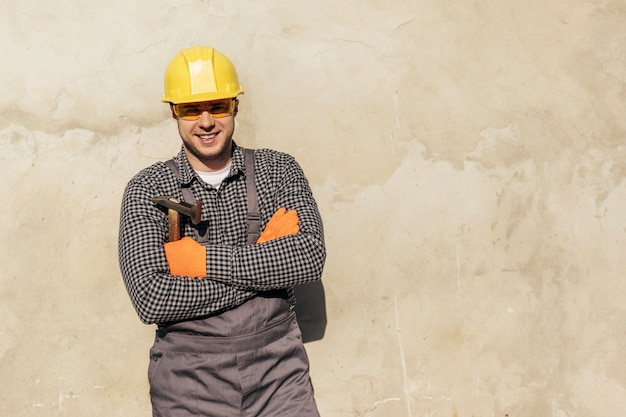Front view of male worker with hard hat and copy space