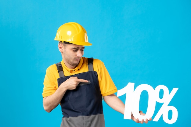 Front view male worker in yellow uniform with writing on blue