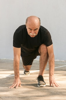 Front view man doing lunges